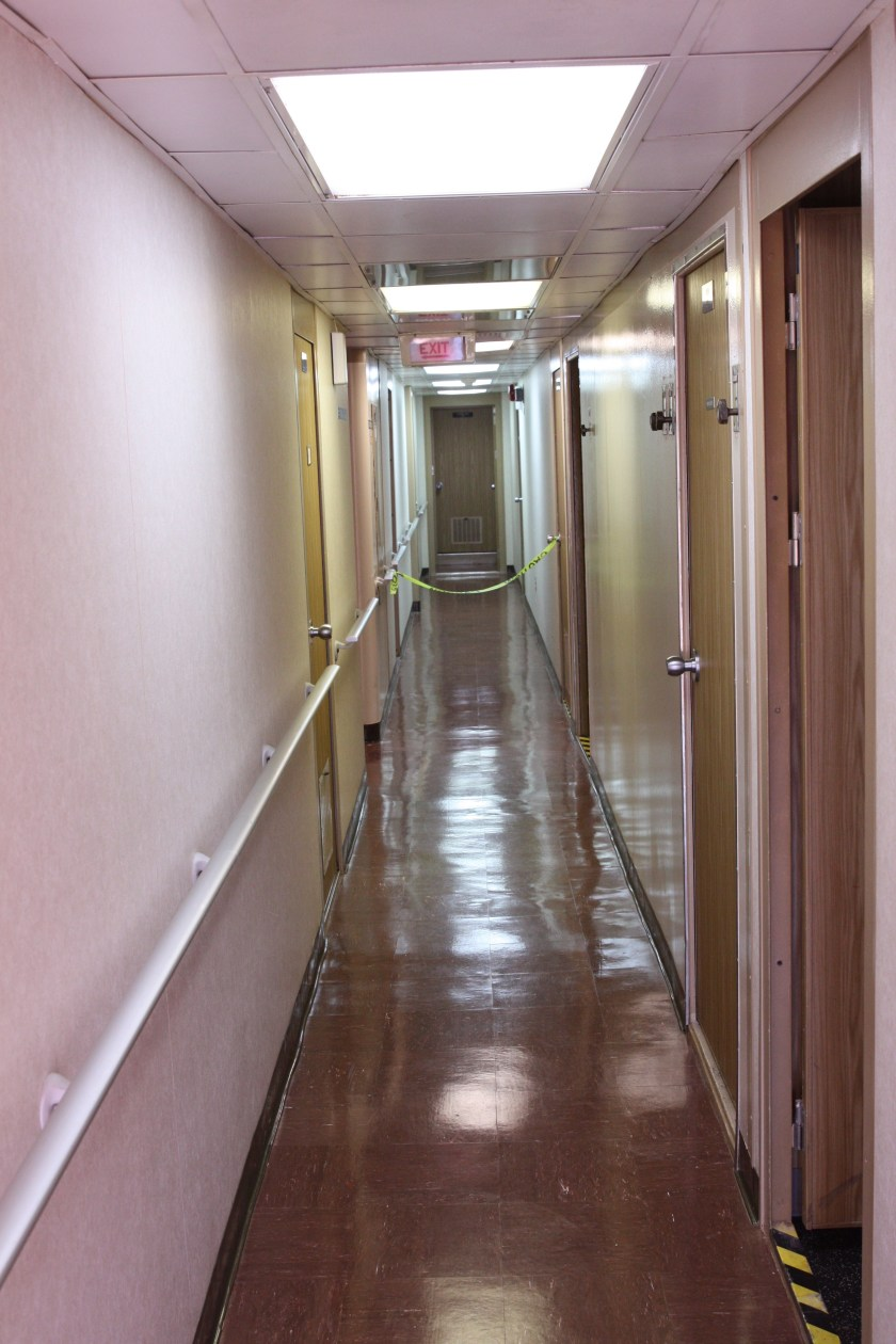 Staterooms line both sides of this corridor.