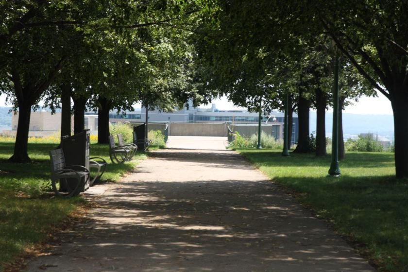 A wide sidewalk leads visitors to the concrete overlook at Cass Gilbert Memorial Park.