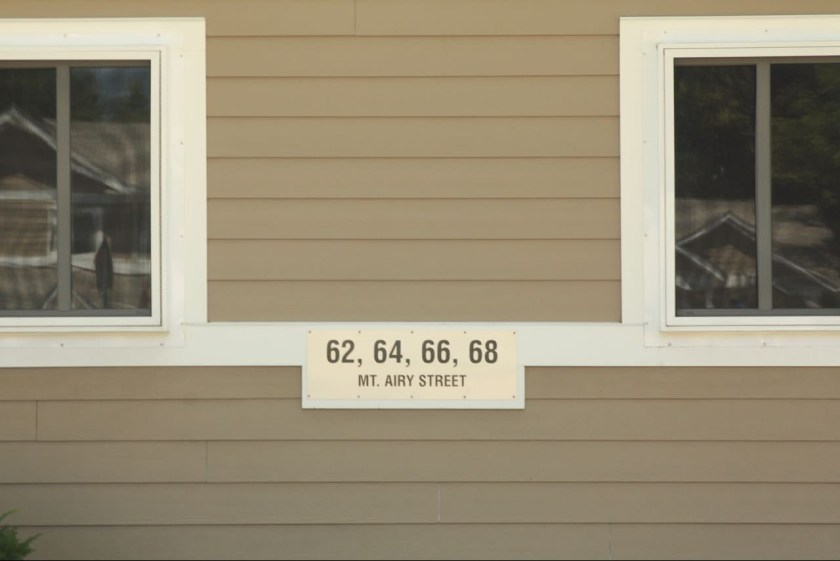 The address sign on a townhome fourplex.