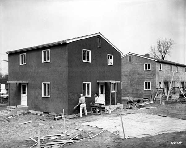 Workers touch up a Mount Airy Townhome building in 1958. Courtesy Minnesota Historical Society