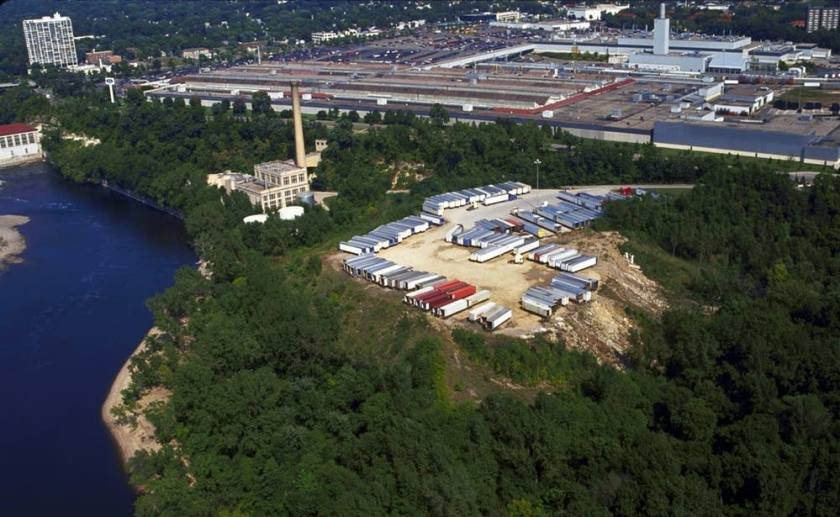 This undated photo shows Area C in the foreground, the concrete-paved trailer lot in the center, and the Ford Twin Cities Assembly Plant in the background. Erosion of the debris pile is apparent on the right (south) side of trailer lot. Courtesy MPR/U of M Regents