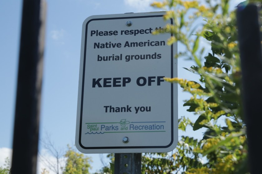 A sign within one fenced area reminds visitors of the sanctity of parts of Indian Mounds Park.