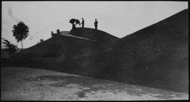 People atop an Indian mound, perhaps being photographed. Note the walking path up the mound. Circa 1910. Courtesy Minnesota Historical Society