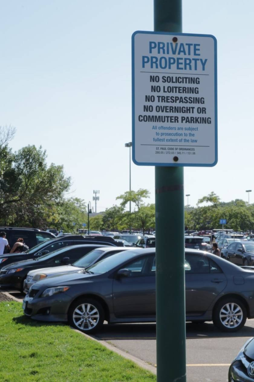 Lots of rules in the Midway Marketplace parking lot. I'm glad I was on my bike.