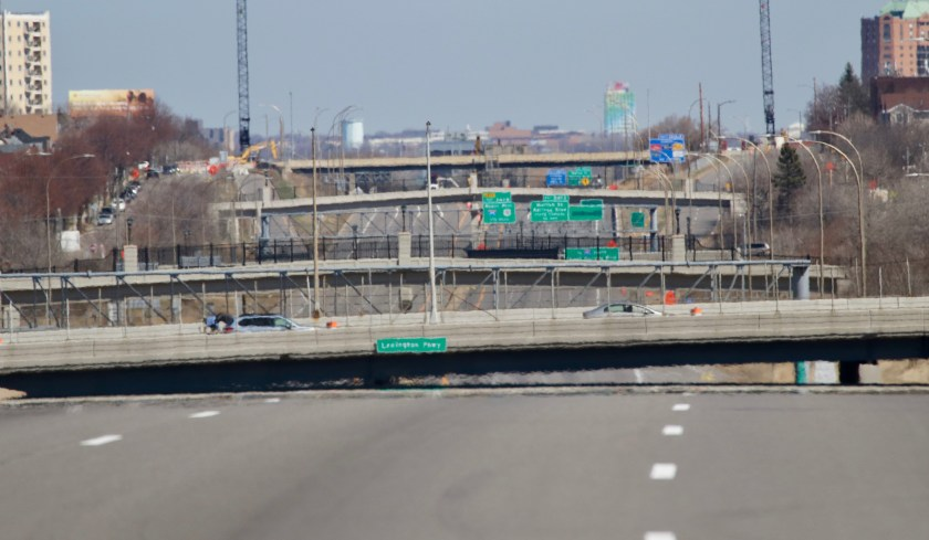 The 300 millimeter lens used compressed the objects in this photo, making many appear much closer than they really were. The bridge near the bottom is Lexington Parkway. Dale Street, bracketed by the cranes, is the fourth bridge and the tall building near the top right of the picture is 3M headquarters in Maplewood, about seven miles to the east.