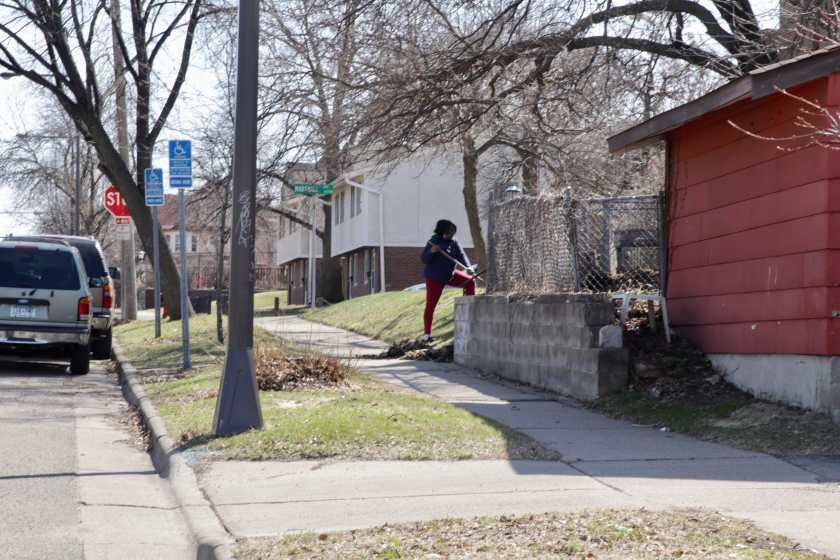 A woman raked her back yard along the 200 block of north Victoria Street.