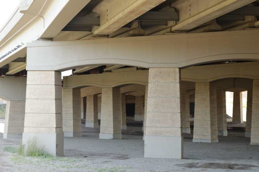 The concrete pillars supporting I-35E north and south and on and off ramps at Cayuga Street, just north of Downtown – 12 lanes total - create a cement maze.