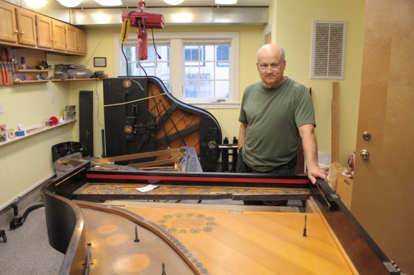 Mark Humphrey with a 100-plus year old Steinway piano in the final stage of renovation.