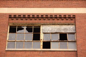 The windows will need replacement but the exterior brick and mortar looks to be in good shape.