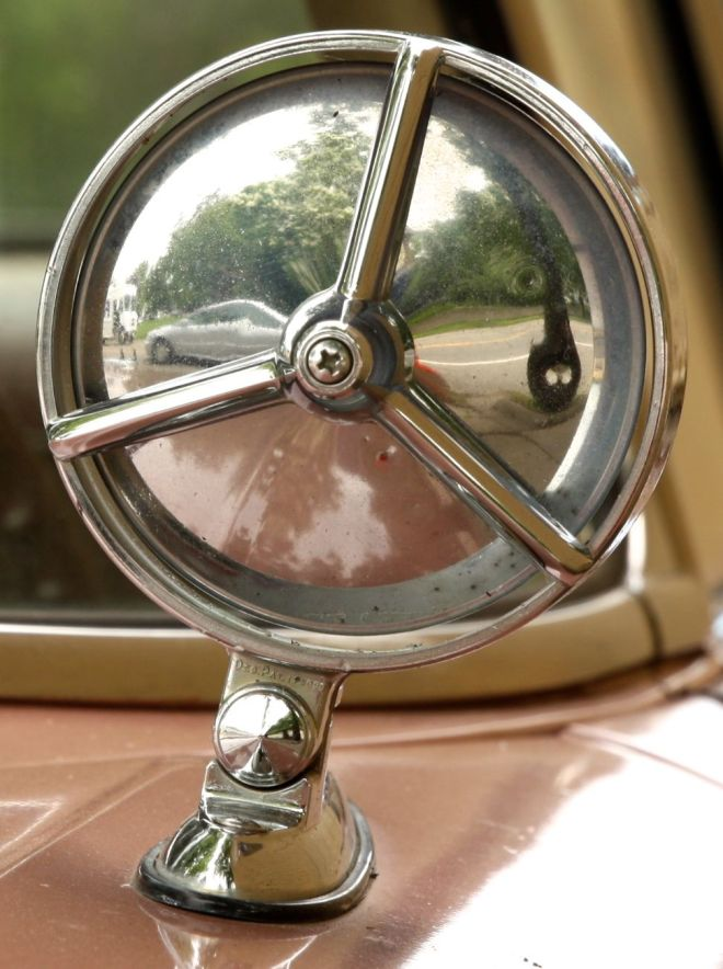 Some '58 Biscaynes have the exterior mirror unusually placed forward of the windshield.