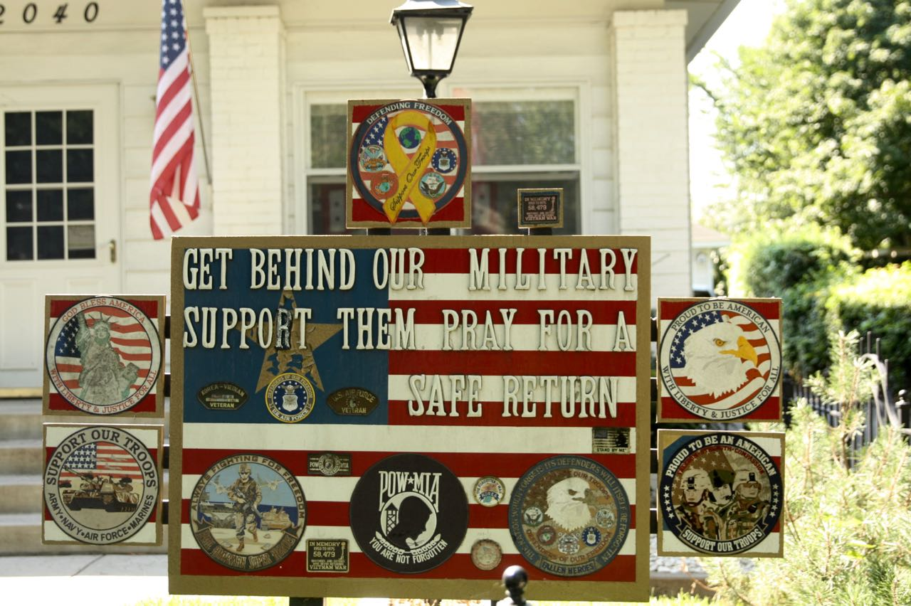 Patches and badges from the Vietnam war through present military campaigns decorate the yard at 2040 Selby Avenue.