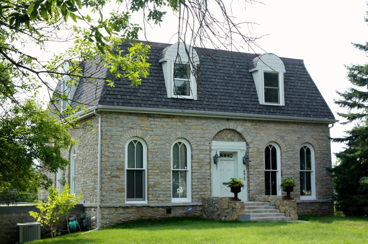 The stone block exterior, Victorian windows and unique look of the home at 698 Stewart nearly stopped me in my tracks.