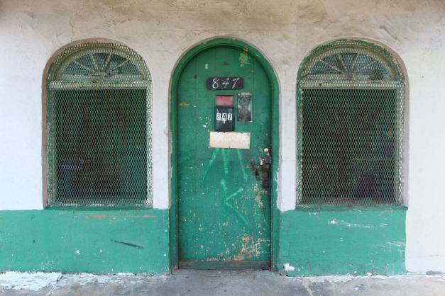 The arched windows and doors add nice flair to a structure with a utilitarian purpose. It must have been remarkable sight in its heyday.