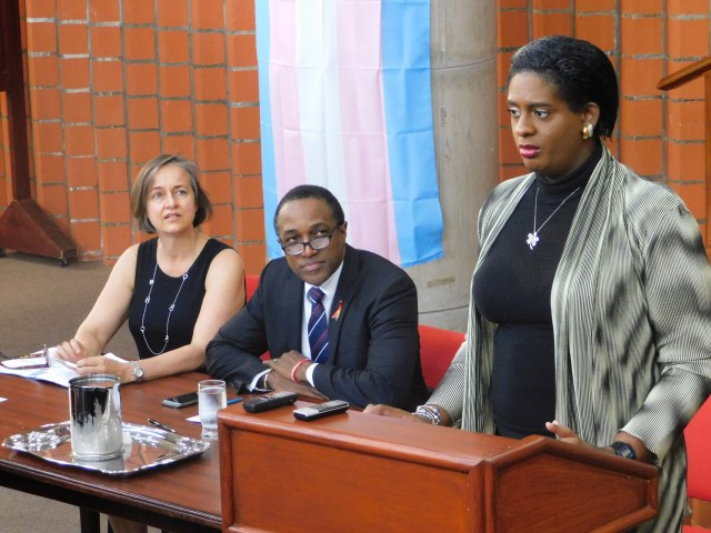 """Yvonne Chisholm (left), pro bono counsel, and Maurice Tomlinson (center), Canadian HIV/AIDS Legal Network senior policy analyst, listen as petitioner Alexa Hoffman (right) speaks at June 2018 press conference announcing lawsuit against the Barbados """"buggery"""" law. (Photo courtesy of the Canadian HIV/AIDS Legal Network)"""