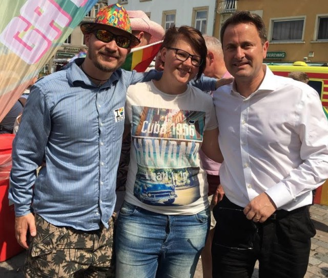 During this year's LGBT Pride celebration in Luxemboug,donor Kenneth Fyrsterling (left) poses with a friend visiting from Estonia and Luxembourg's prime minister, Xavier Bettel (right). (Photo courtesy of Kenneth Fyrsterling)