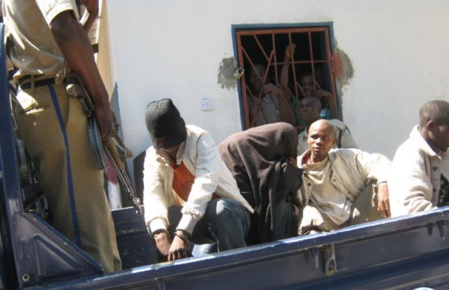 After their conviction in Zambia on Aug. 3 for gay sex, two men are loaded into a pickup truck to be transported back to jail. (Photo courtesy of Lusaka Times)