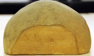 Cast of back of skull with Bede's name.