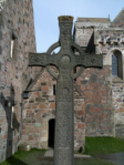 A replica of St. John's High Cross in front of Columba's Chapel likely built upon the place where Columba was buried. Connected to Iona Abbey. Took this photo Sept. 2009. Original St. John's Cross is in the museum behind the Abbey