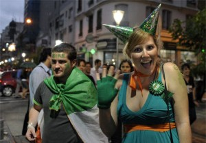 An Irish woman waves for a picture as she arrives to a pub in downtown Buenos Aires to celebrates Saint Patrick's Day on March 17, 2010. AFP PHOTO / JUAN MABROMATA (Photo credit should read JUAN MABROMATA/AFP/Getty Images)
