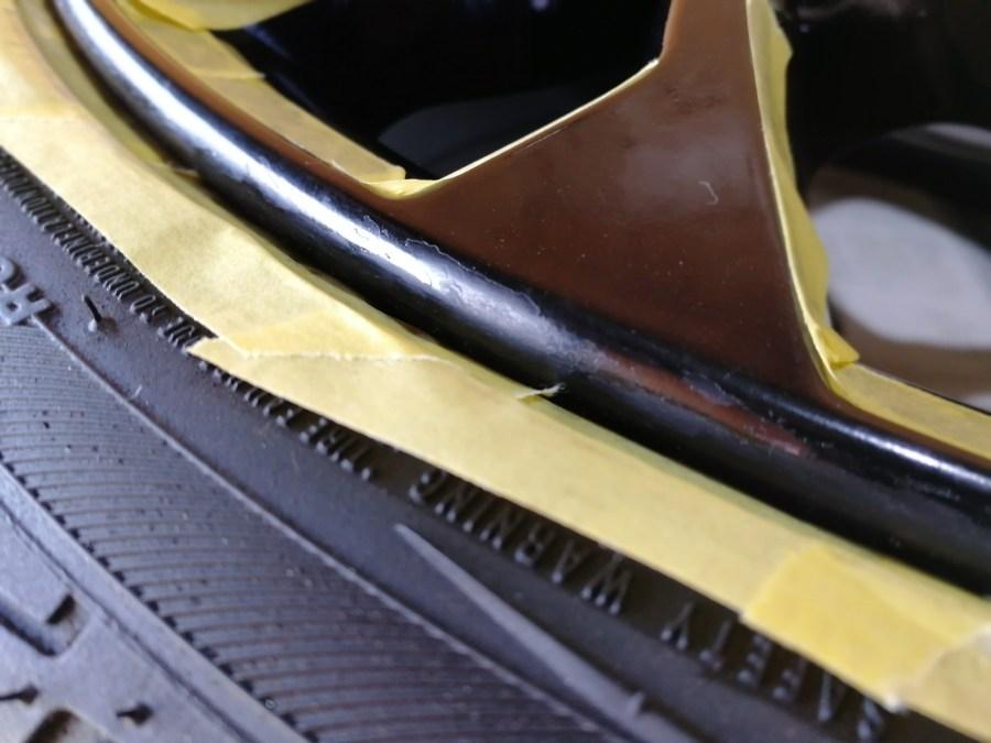 ルノールーテシア シャシーカップ純正ホイール 艶有ブラックホイール 傷補修前