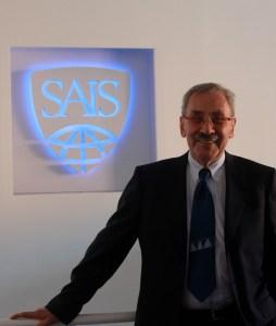 SAIS Europe Director Kenneth Keller displays the new SAIS logo. (Rachel Finan)