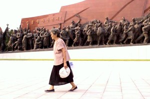 A North Korean woman walks through a public square in Pyongyang. (YIQIAN SUNNY XU)