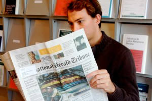 Austrian student Philip Schanttinger peruses the International Herald Tribune. (Rachel Finan)