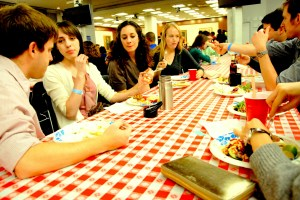 Students enjoy a variety of international food at the Kenney Auditorium.  (SARAH RASHID)