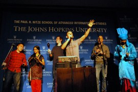 Joseph Geni blends vocals and song with the help of some volunteers from the audience. (Sarah Rashid)