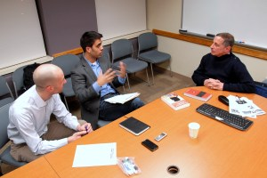 Gutman talks with the Observer editorial staff, Jameel Khan and Selim Koru. (SARAH RASHID)