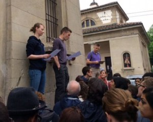 Meaghan Doherty and Philipp Hitaky provide a briefing to the troops on the German checkpoint at Porta Santo Stefano during the Bologna WWII Club History Tour.