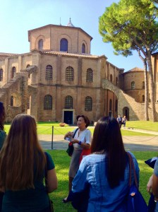 Standing before the Basilica of San Vitale in Ravenna, Italy, Prof. Anna Cavina prepares her class with some background on the 6th-century church.