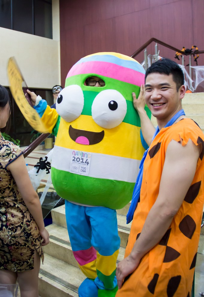 HNC students Fred Flintstone and that mascot thing for the Nanjing youth Olympics enjoy their night.