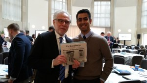 The author meets SAIS alumnus and CNN news anchor Wolf Blitzer at the Future of War conference on Wednesday, Feb. 25, and gives him two issues of The SAIS Observer. (Photo: Seethal Kumar)