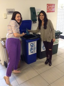 Maddy McCartney and Nicole Ahdiyyih make sure a glass bottle ends up in the right recycling bin. (Photo by Bryn Jansson)