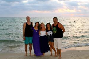 HNC students appreciate the sunset at a beach in Sihanoukville, Cambodia. (Photo: Ashley Johnson)