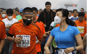 Pauley - Illustration 2 Runners wearing masks during the 2014 Shanghai Marathjon