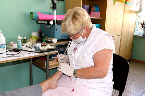 Doctor treats foot ailment