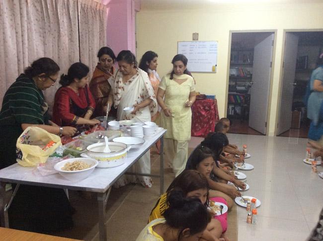 Serving food to children at Sai Prashanti Centre