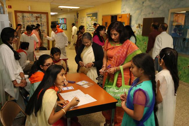 SSE children at the registration desk