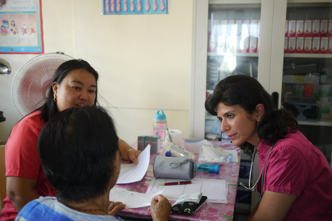 Philippines - Dulag Medical Camp - Doctor examines patient