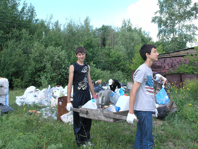 Children helping to clean up