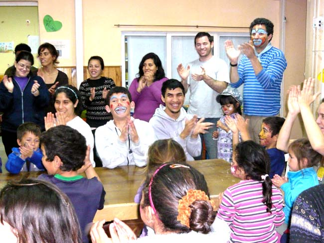 Volunteers singing with the disadvantaged, Florencio Varela, Buenos Aires, Argentina