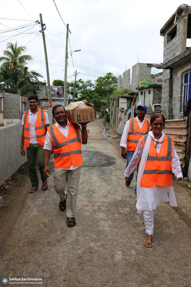 Mauritius Relief Volunteers serving flood victims