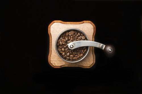 Coffee mill isolated on black background