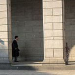 I walked by one of the courts in Singapore and shot these two pictures of young lawyer stralling around