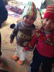 Our donated hats on happy recipeints in Jordan