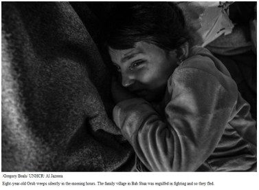 Eight-year-old Orub weeps silently in the morning hours. The family village in Bab Sbaa was engulfed in fighting and so they fled.