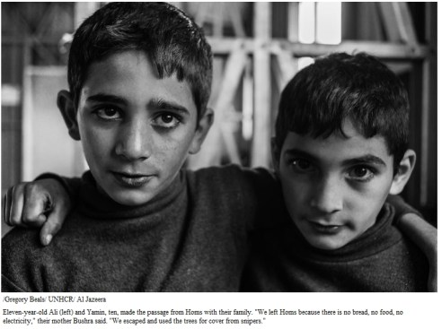 """Eleven-year-old Ali (left) and Yamin, ten, made the passage from Homs with their family. """"We left Homs because there is no bread, no food, no electricity,"""" their mother Bushra said. """"We escaped and used the trees for cover from snipers."""""""