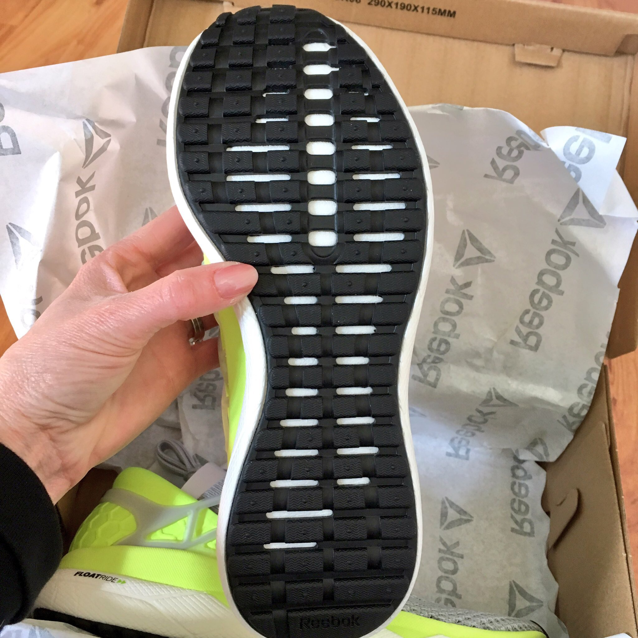 The women's colour is light grey and fluoro yellow, while the mens are black and blue. The grey upper is stretchy like a sock, called ultraknit, with a supportive plastic cage. This provides support yet comfort for wider feet, but also accommodates a narrower foot (like mine), due to the elasticity of the material. The heel is more rigid, like a traditional running shoe to give support.